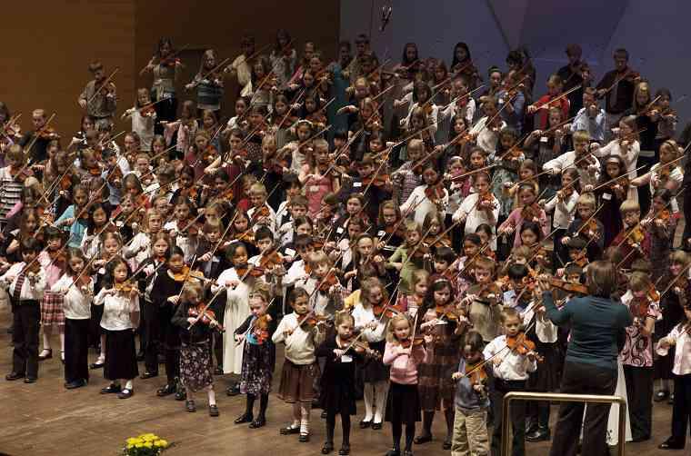 Violin students perform at the Suzuki Association of Minnesota graduation recital.