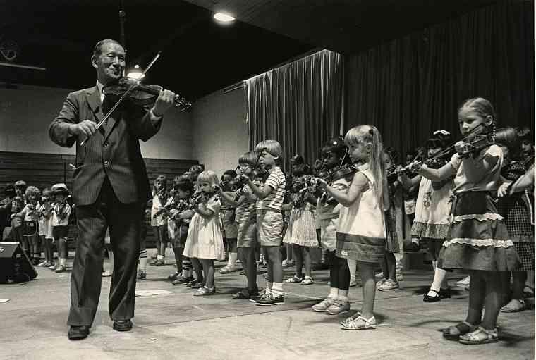 Dr. Shinichi Suzuki Leads a Student Violin Group
