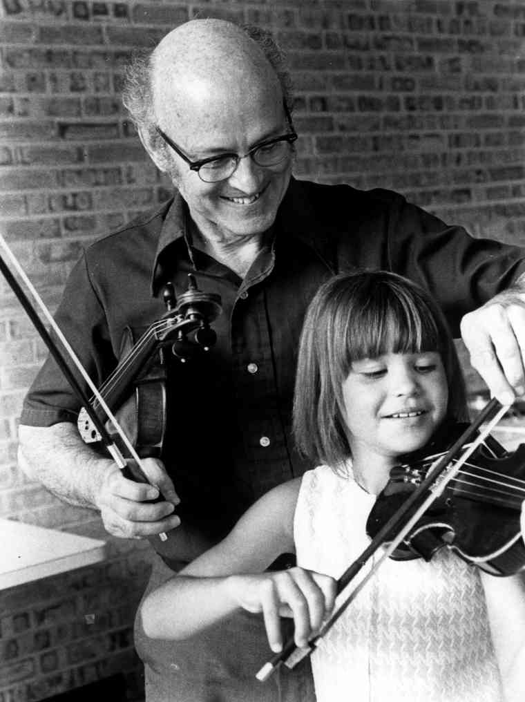 John Kendall in a violin lesson
