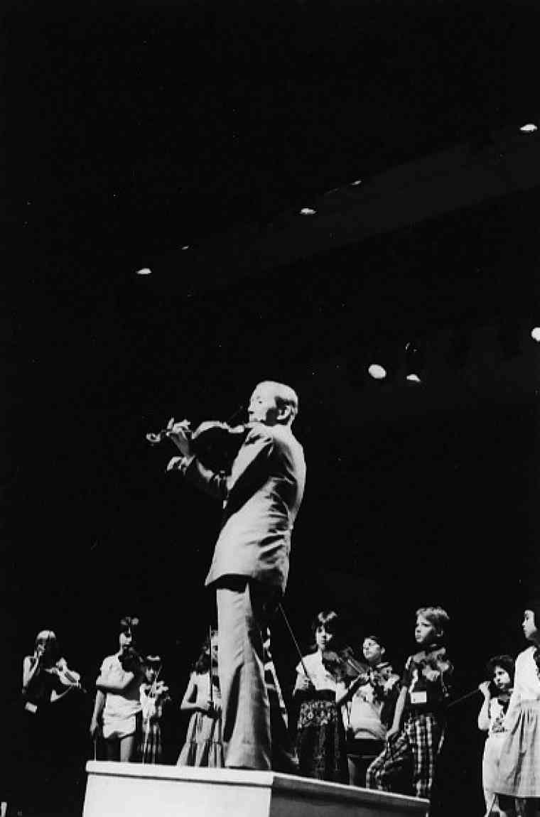 Dr. Shinichi Suzuki leads a student violin group in Amherst in 1981