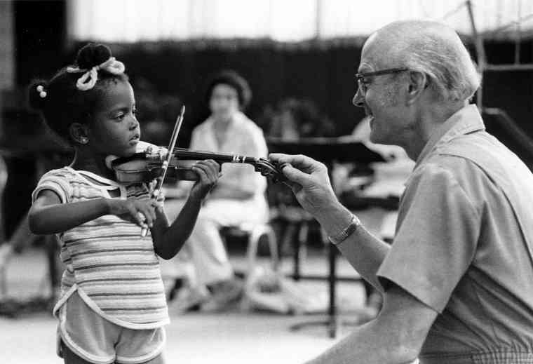 John Kendall teaching a young violin student