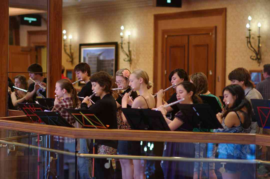 The Flute Performing Ensemble gives an impromptu performance on the balcony