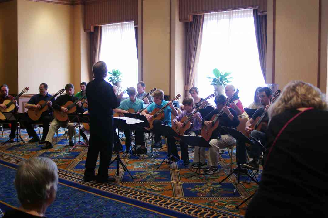 David Madsen conducts the guitar ensemble at the 2012 conference