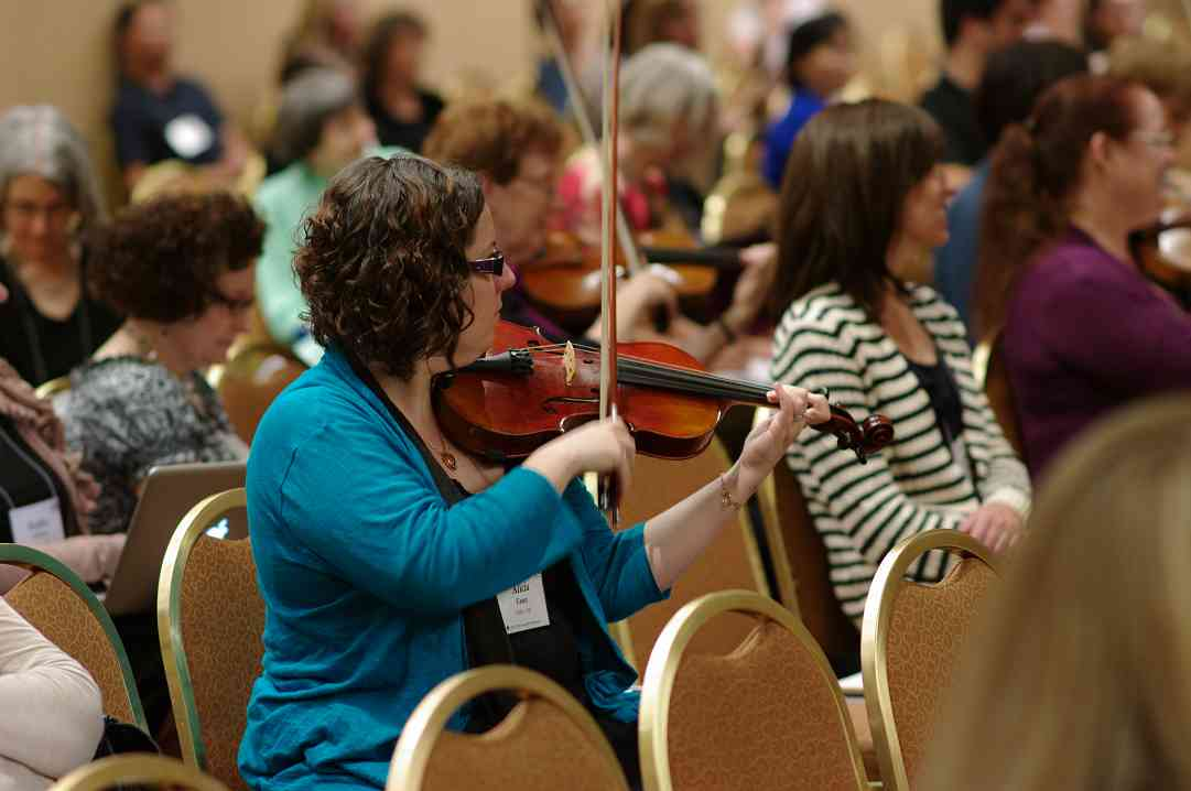 Playing along with a violin session at the 2012 conference