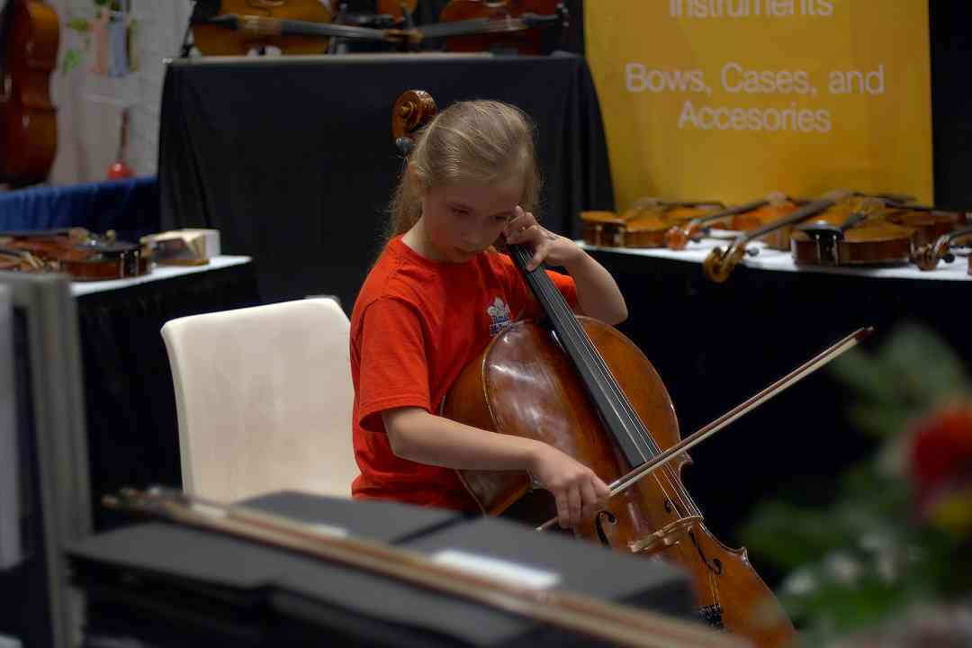 Trying out a cello at the 2006 SAA Conference exhibits