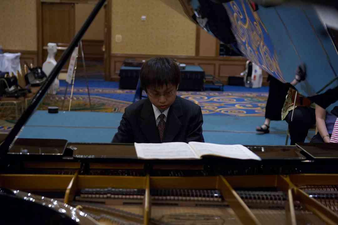 "Xinran ""Ryan"" Liu rehearses for the piano concerto performance at the 2006 SAA Conference"