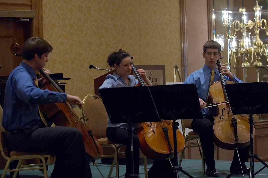 Bryant Hopkins, Olivia Burzynska-Hernandez, and Patrick Hopkins in the cello ensemble masterclass at the 2006 SAA Conference