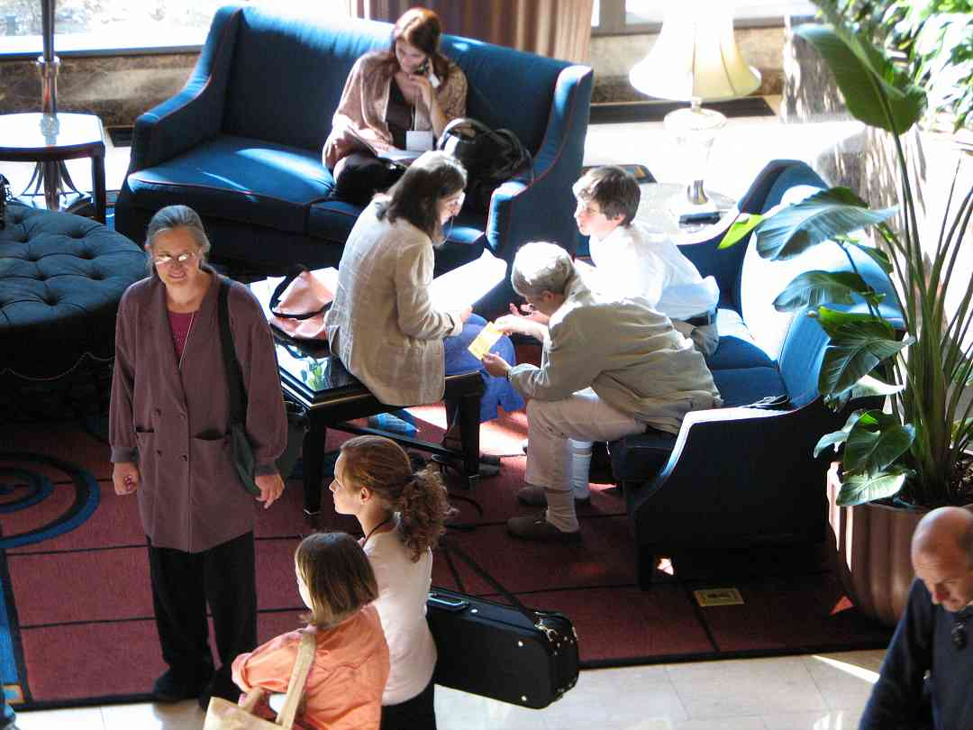 Suzuki people take a break in the lobby.