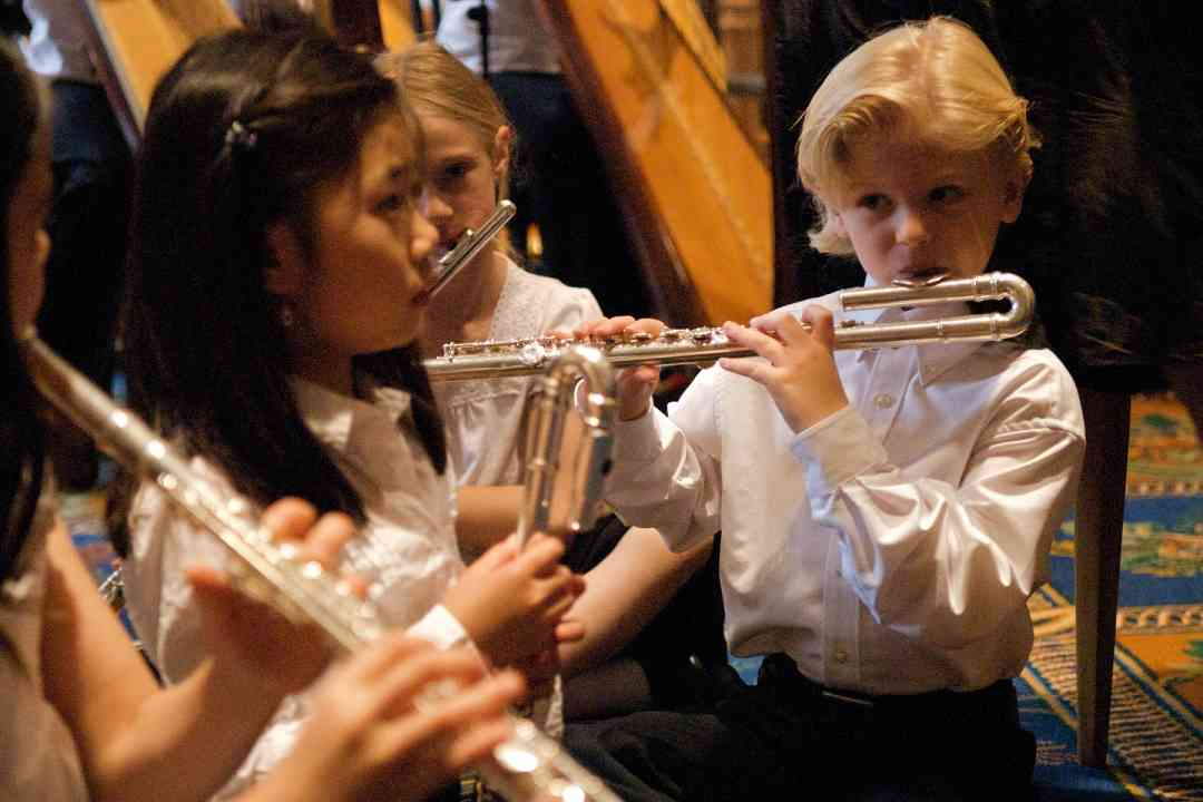 Flute choir students warm up for their performance at the 2008 SAA Conference