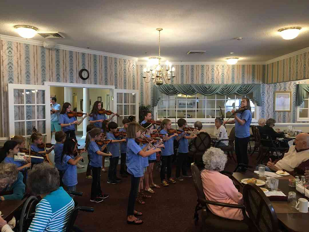 Deakins Suzuki Strings Performing at Summit Place