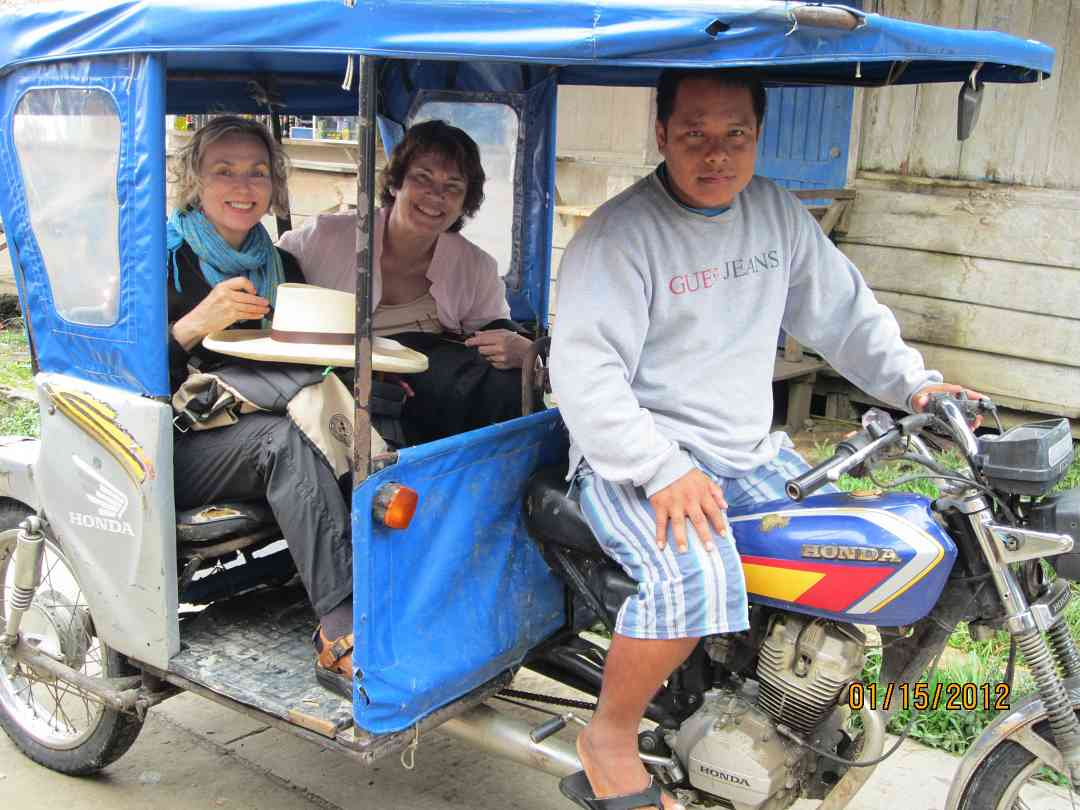 Mary and Nancy with Abelardo in his three-wheeled Iquitos taxi