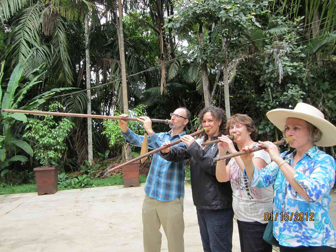 David, Kelly, Nancy and Mary try out blowguns