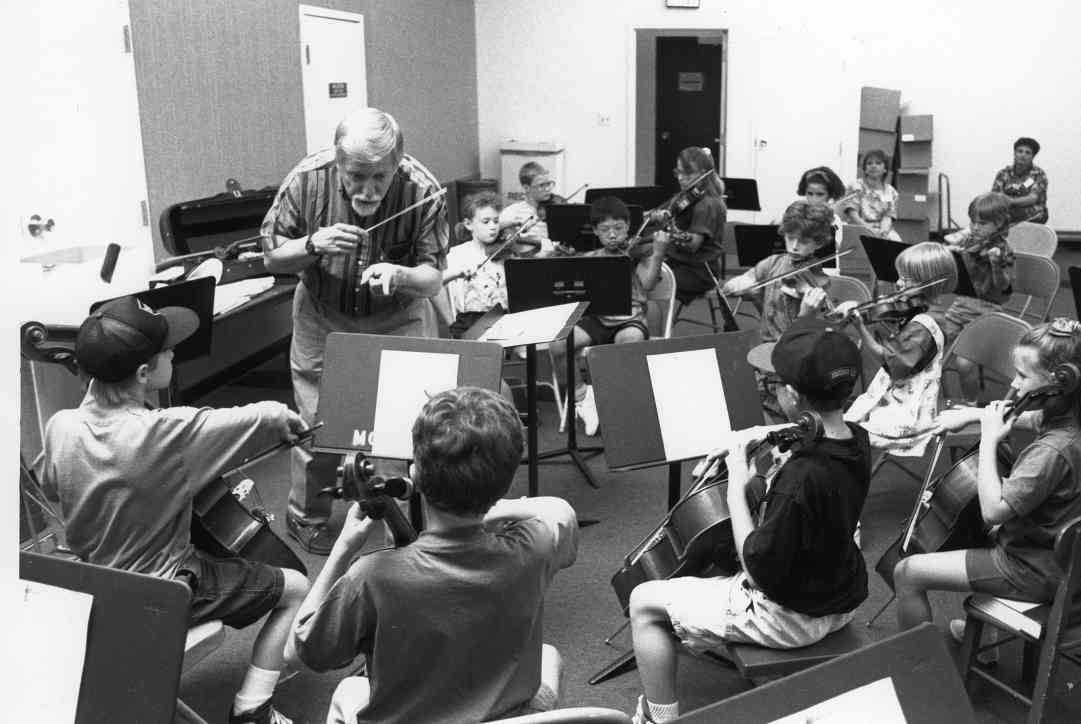 David Einfeldt rehearses with a student orchestra