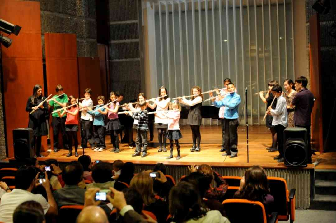 Student group in Bogota, with teacher Diana Bettin, performing at the concert where Nicolas was presented with his flute