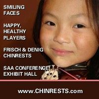 Advertisement: Smiling Faces. Happy, Healthy Players. Frisch & Denig Chinrests. SAA Conference Exhibit Hall.