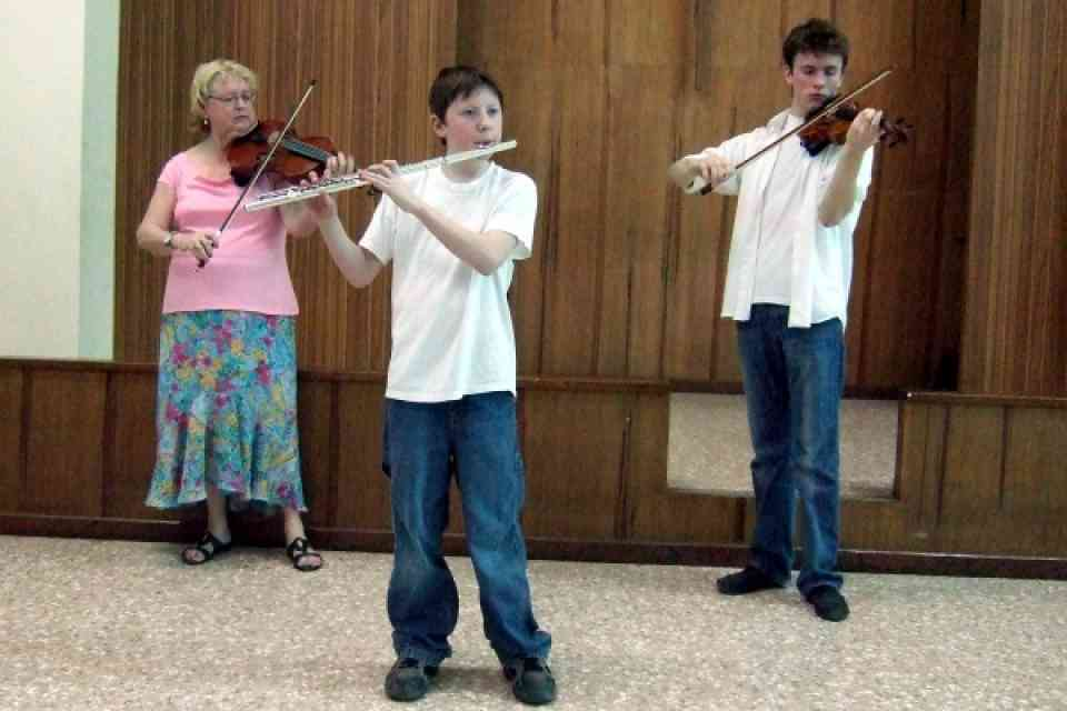 Carmen Wise, Thomas, and Jeffrey playing Child of the Poor
