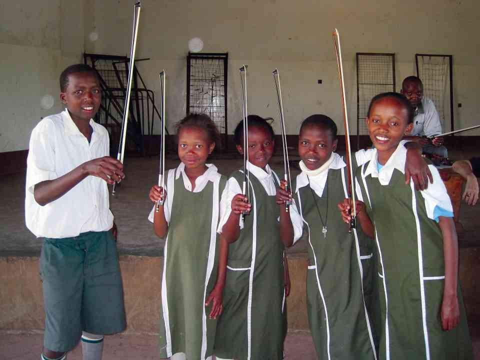 Students display their bow holds on the first day of lessons