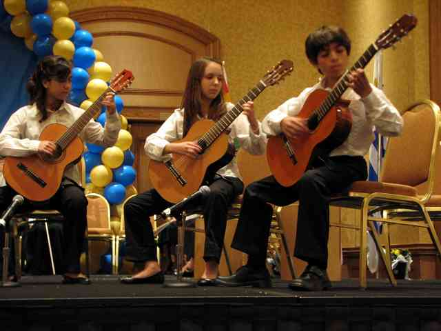 Guitarists in the Latin American Suzuki Ensemble perform at the 2008 SAA Conference