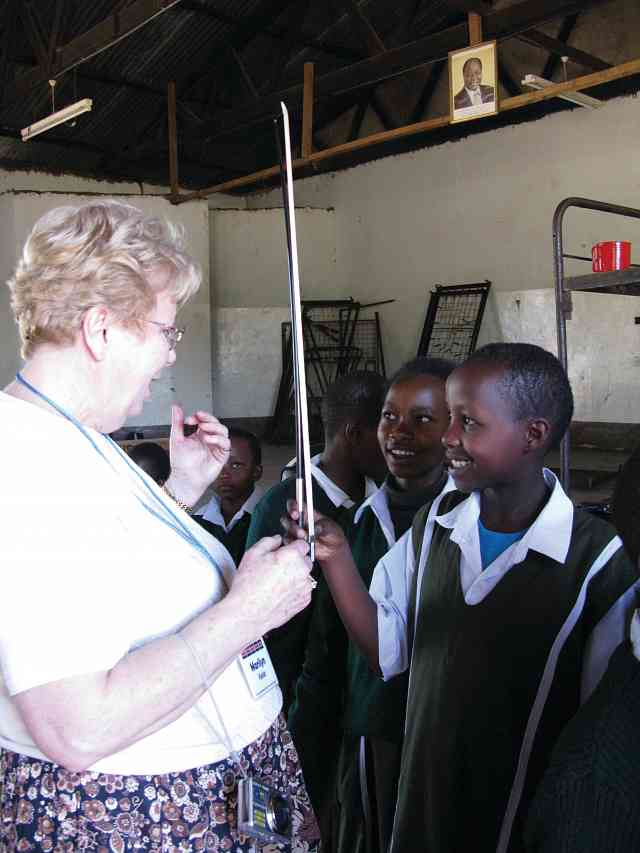 Marilyn Kesler works with students