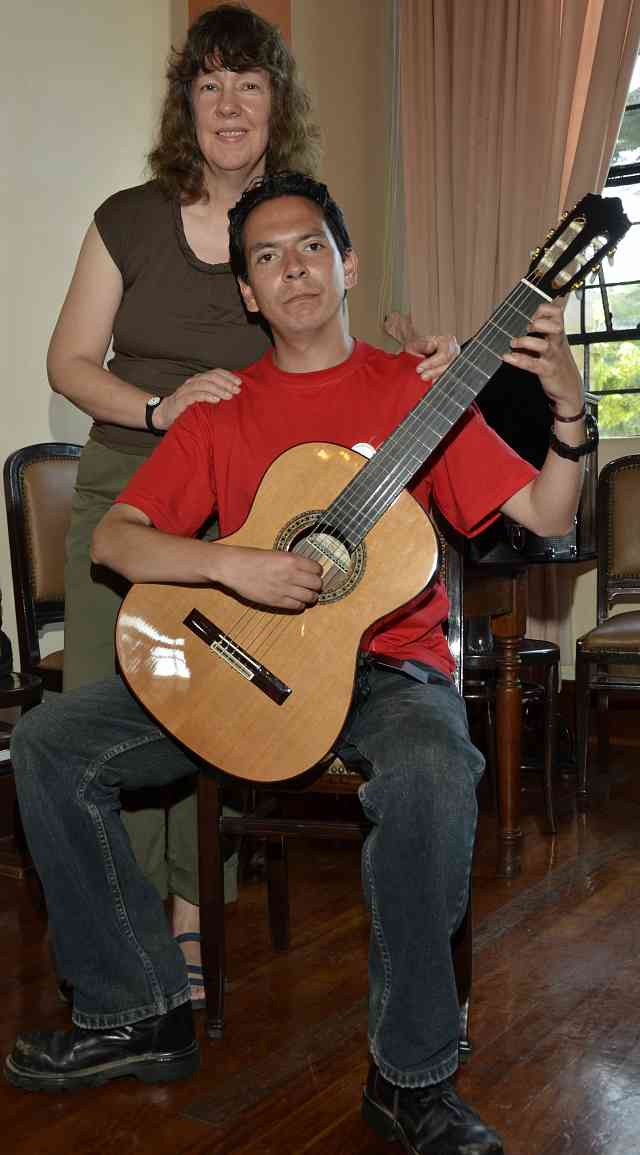 MaryLou Roberts and teacher David with donated guitar