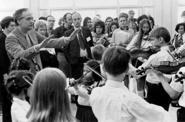 William Starr conducting a student orchestra