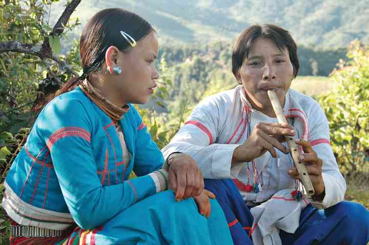 Lahu Shi couple, courting ritual, Song and Tae Lae flute, Keng Tung, Myanmar/Burma, 2005