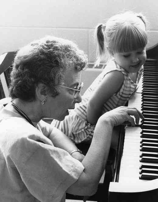 Doris Koppelman with piano student