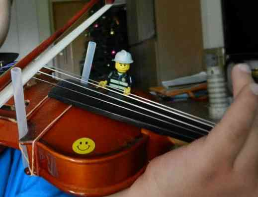 Lego man Riding on Violin