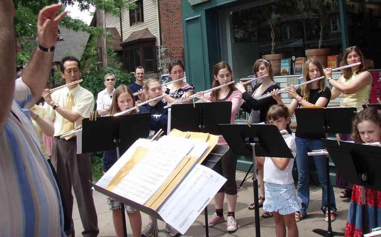 Sidewalk serenade at Great Lakes Suzuki Flute and Recorder Institute