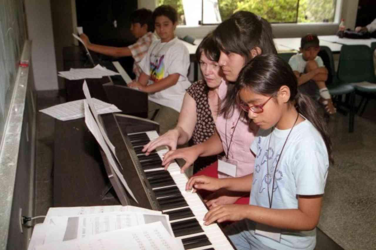 Mary McCarthy teaching a piano group class